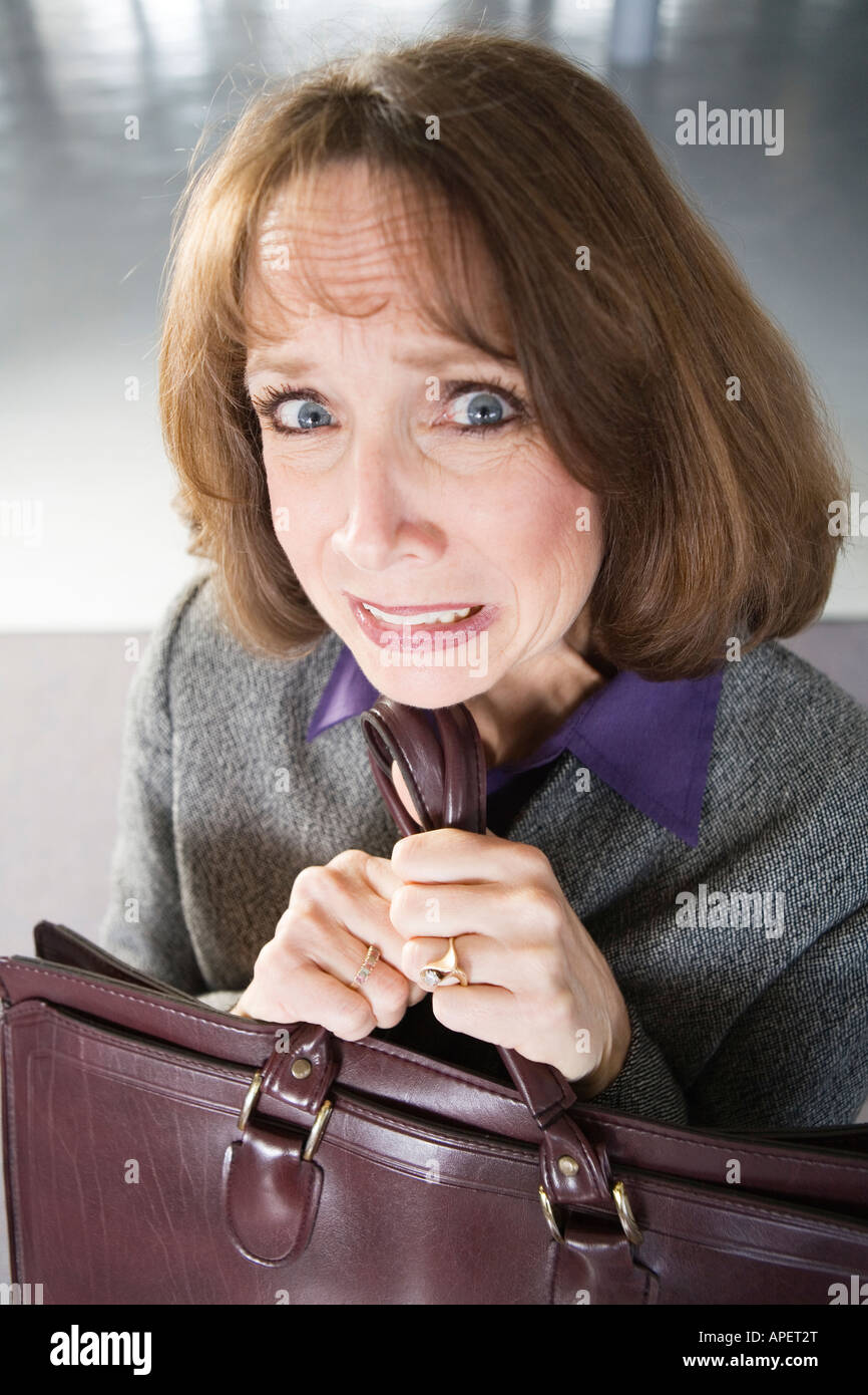 Portrait of a shocked business woman. - Stock Image