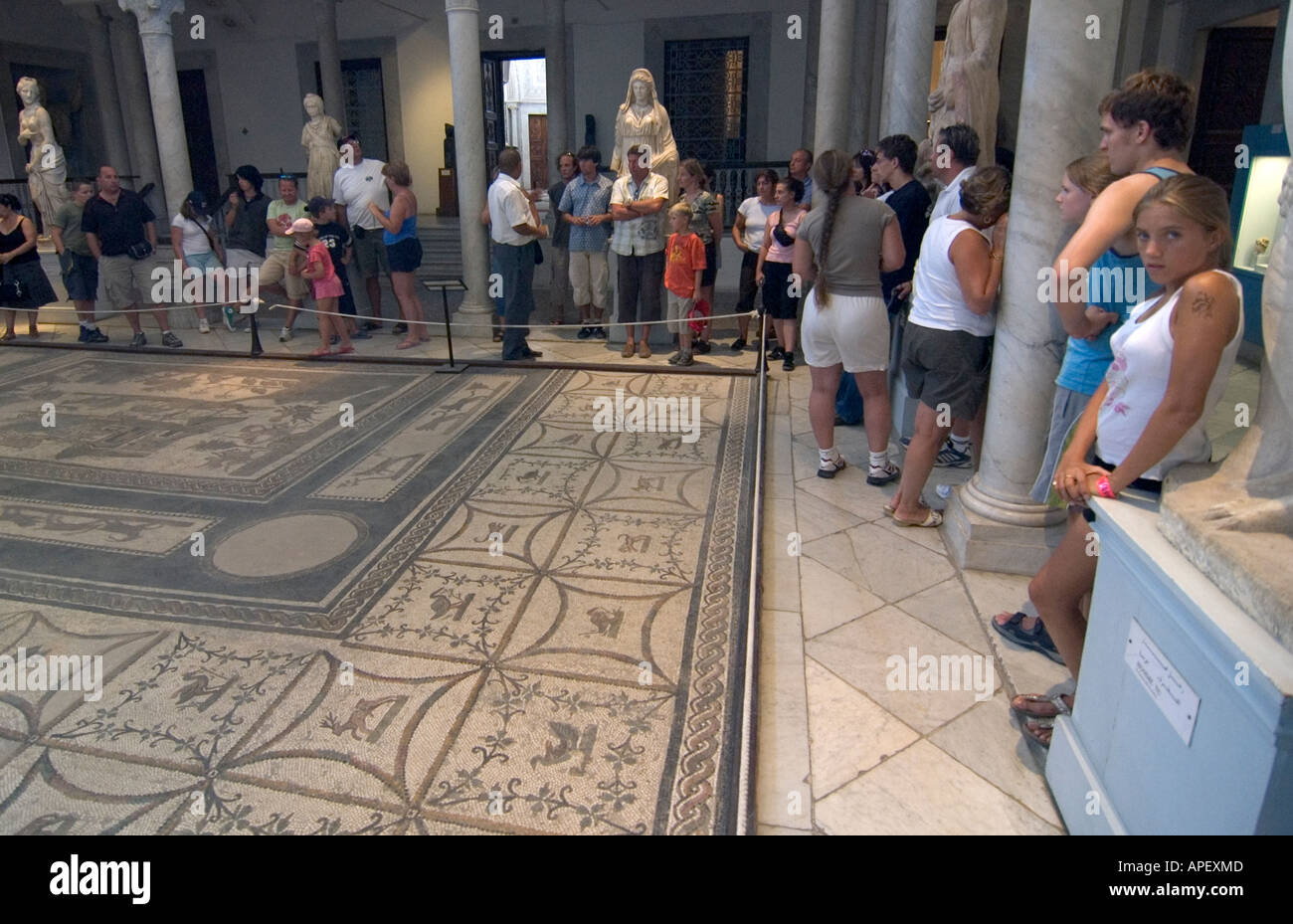 Tourists looking at Roman mosaics in the museum of Bardo, in Tunis, Tunisia. Stock Photo
