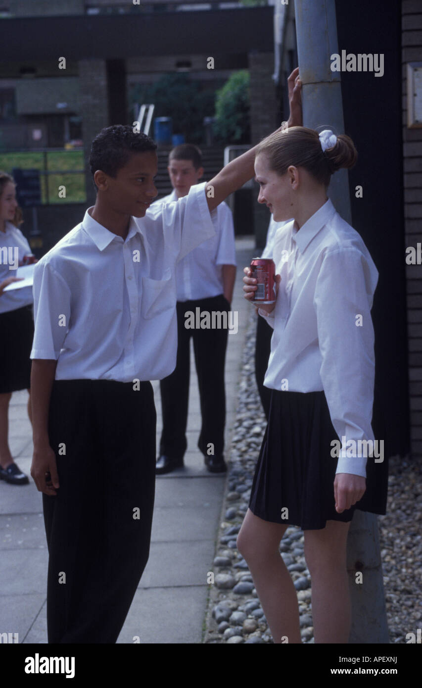 boy chatting up girl in school - Stock Image