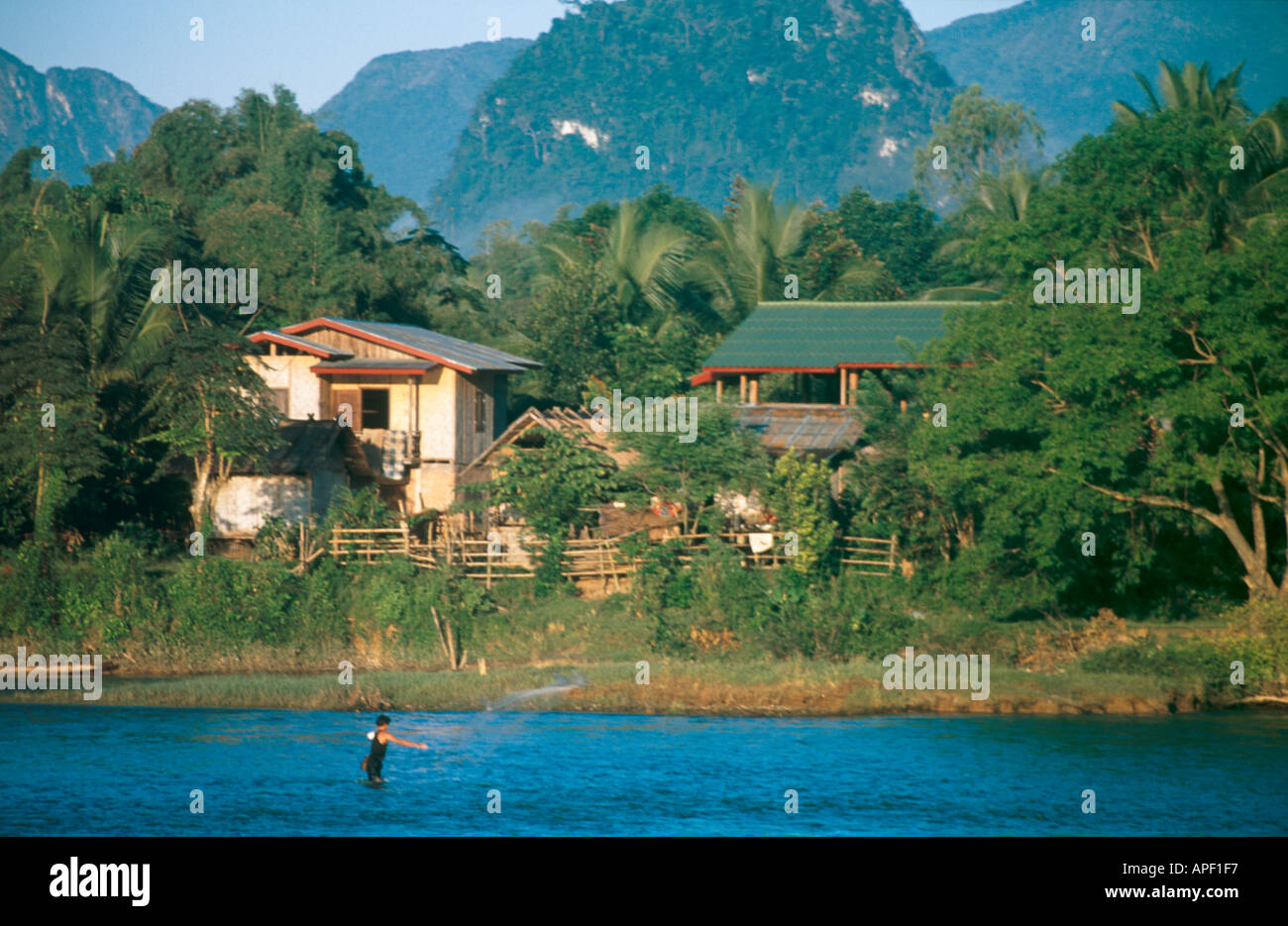 Fishing with nets on the Mekong River Vang Vieng Laos Stock Photo