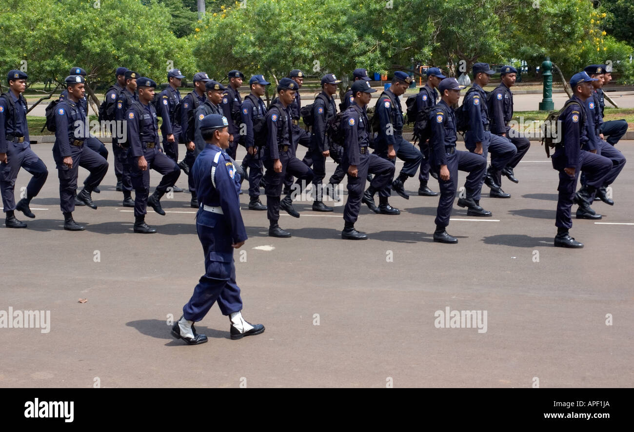 Indonesian police officers in central Jakarta practising marching and saluting, Indonesia. Stock Photo