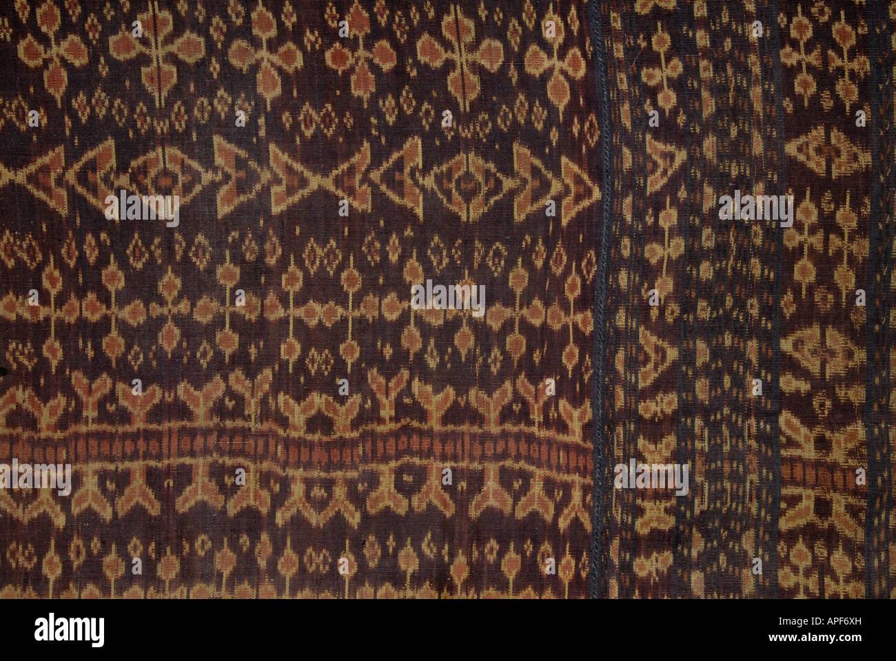 Detail of a warp ikat decorated hinggi from Nusa Tengarra Indonesi - Stock Image