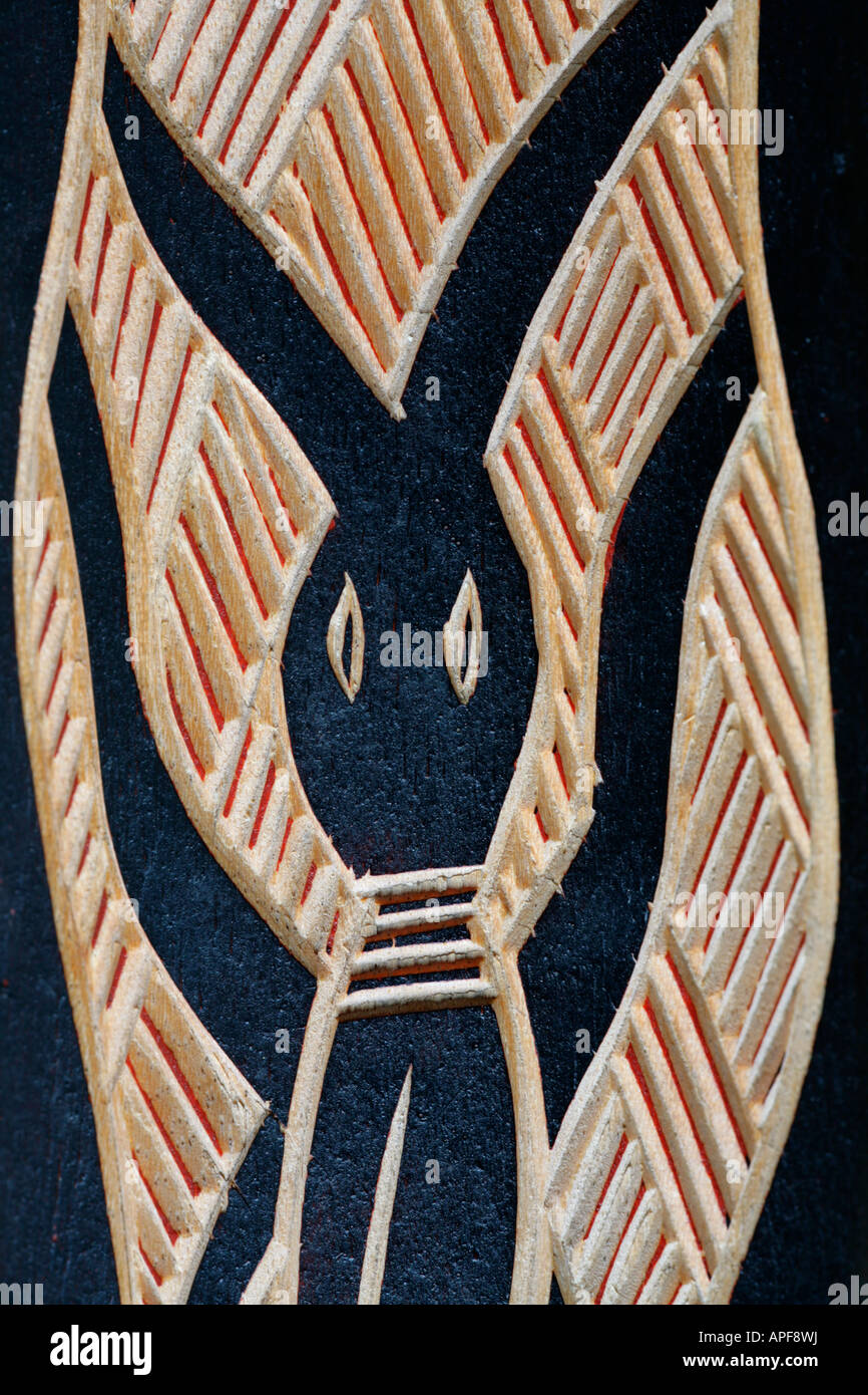 Traditional Australian aboriginal primitive art wood carving of symbolic beetle figure. - Stock Image
