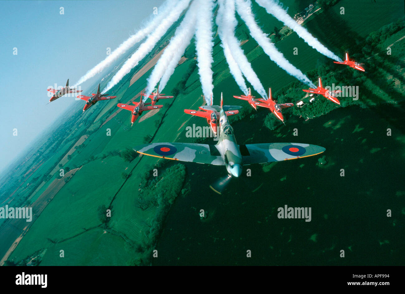 Red Arrows aerobatic team with spitfire - Stock Image