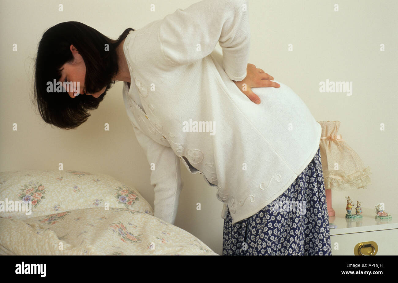 pregnant woman with backache - Stock Image