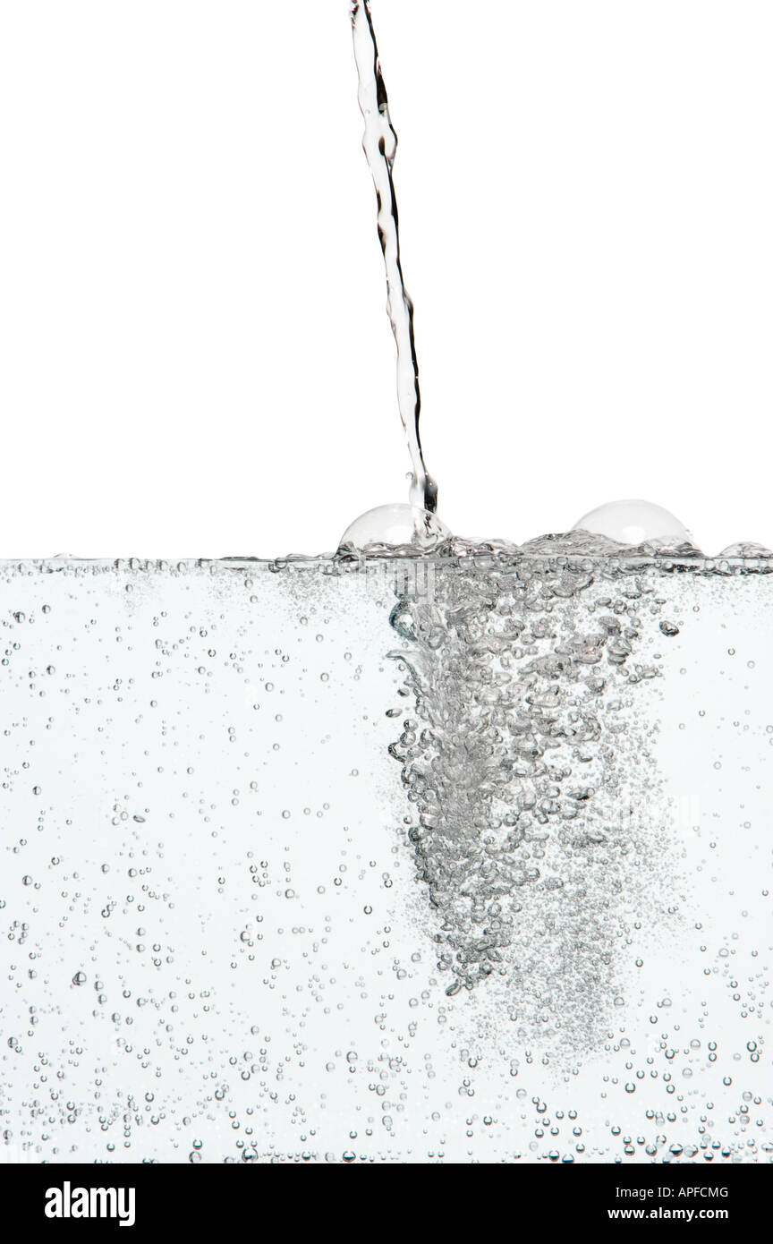 Pouring carbonated water - Stock Image