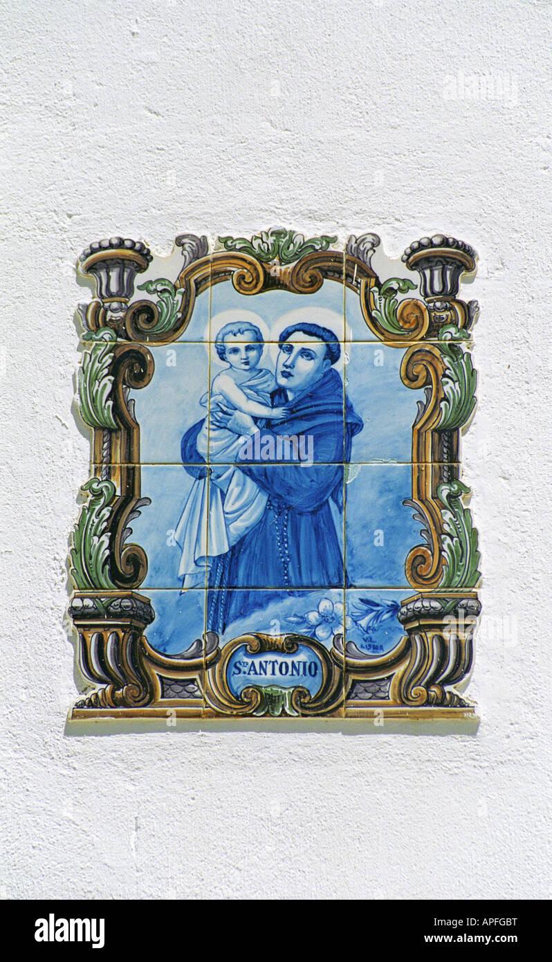 Decorative tiles on house wall near Ferragudo church, Algarve, Portugal, Summer 2007 - Stock Image