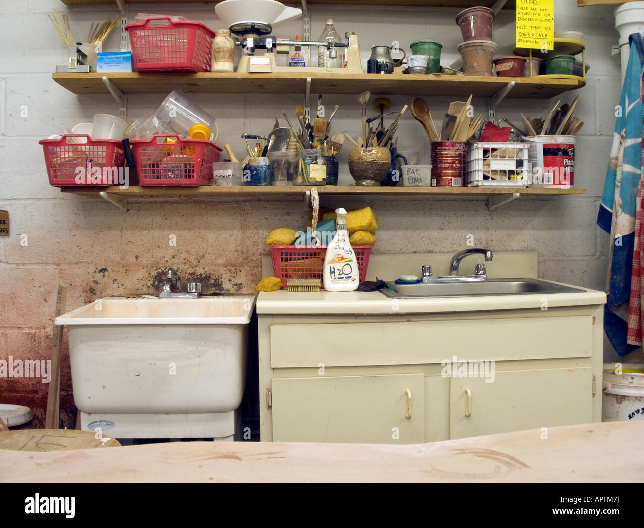 Sink and tool storage in a pottery studio - Stock Image