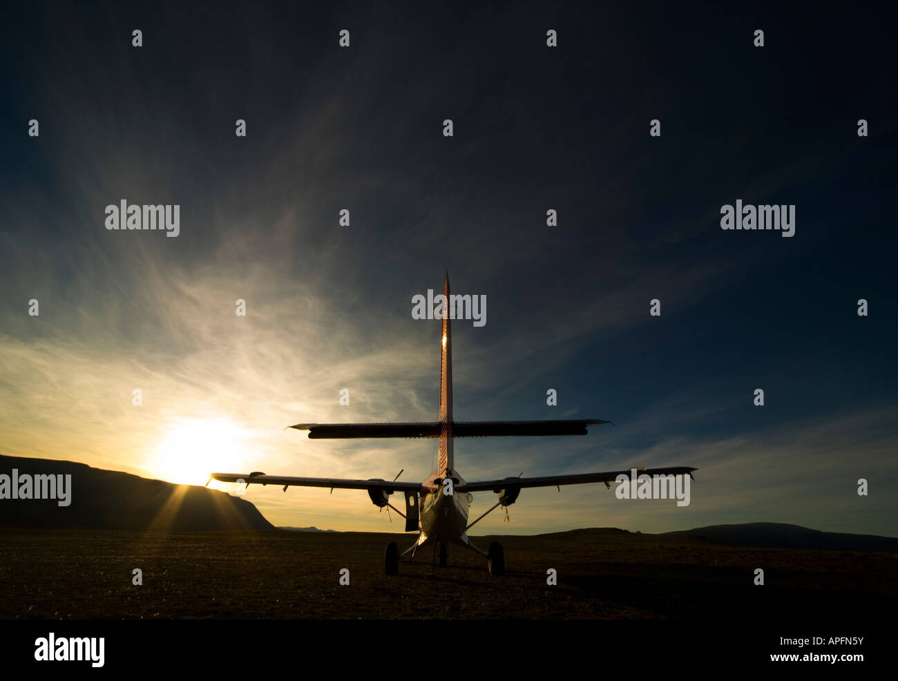 Small aircraft silhouette - Stock Image