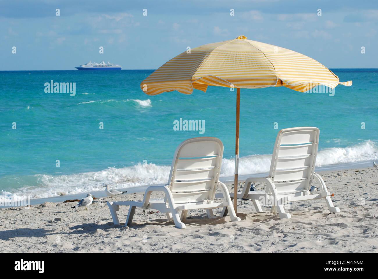 Sun loungers on Miami beach, Florida, USA - Stock Image