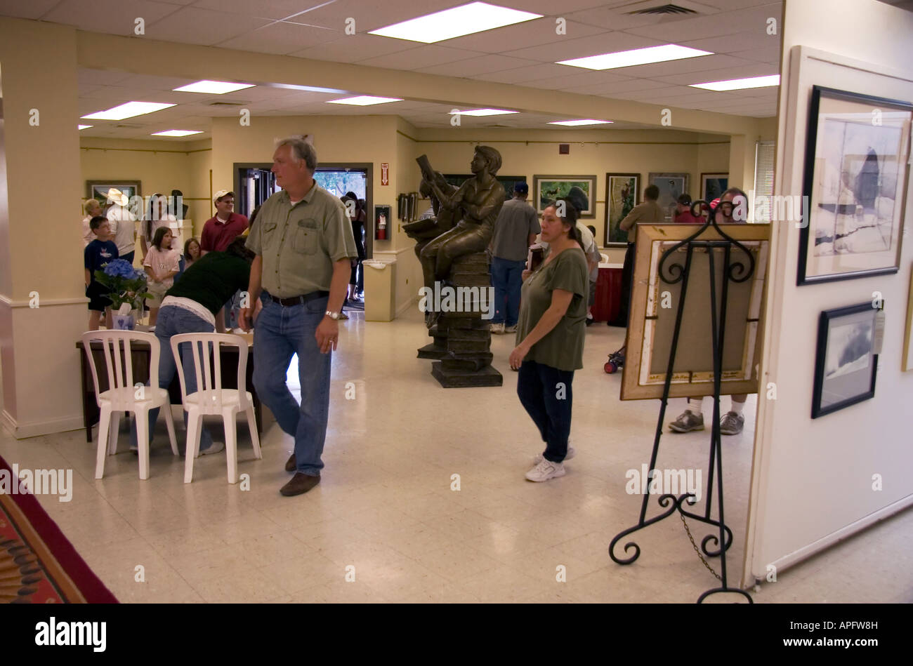People milling about & appreciating the many works of art on display at this Art Exhibit at the Utah State Fair - Stock Image