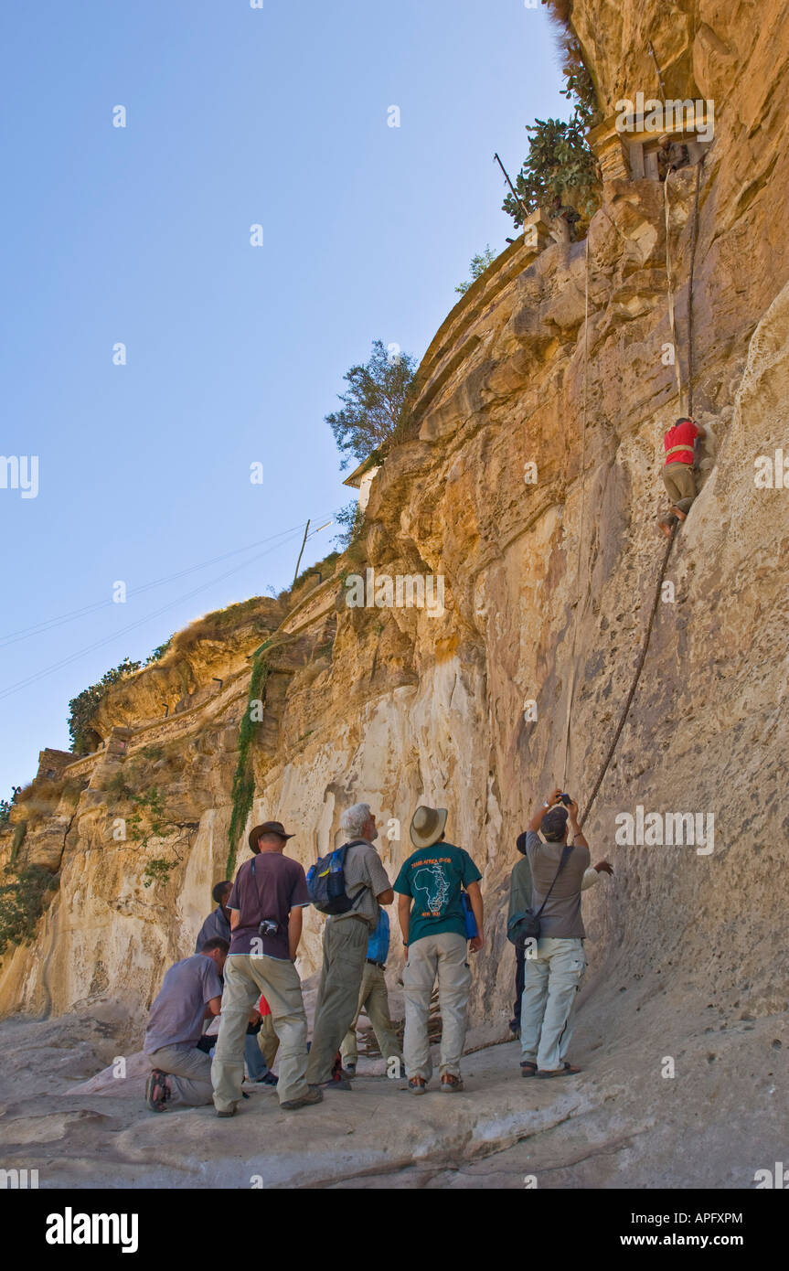 Tourists climb up to the entrance of the Debre Demo monastery. - Stock Image