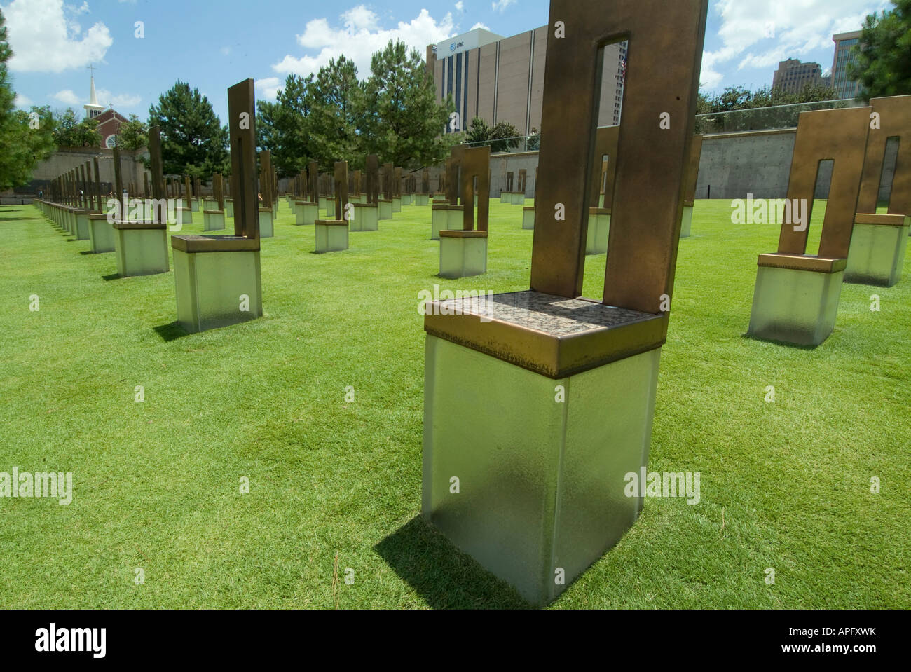 The Field of Empty Chairs on the  Oklahoma City National Memorial site of the Alfred P Murrah federal building. Stock Photo