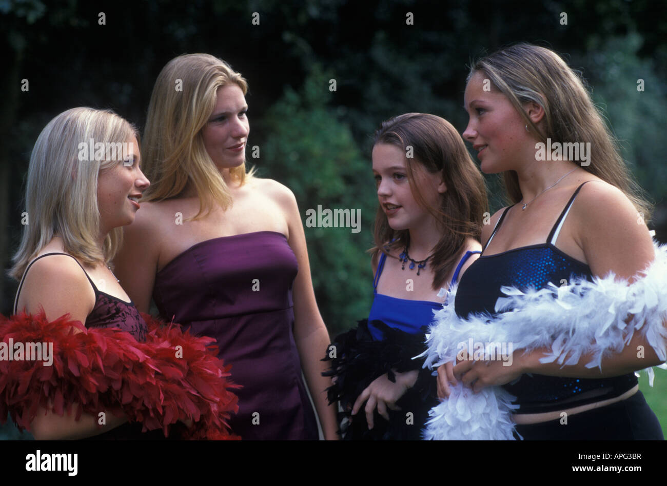 group of teenage girls dressed up in their prom dresses Stock Photo ...