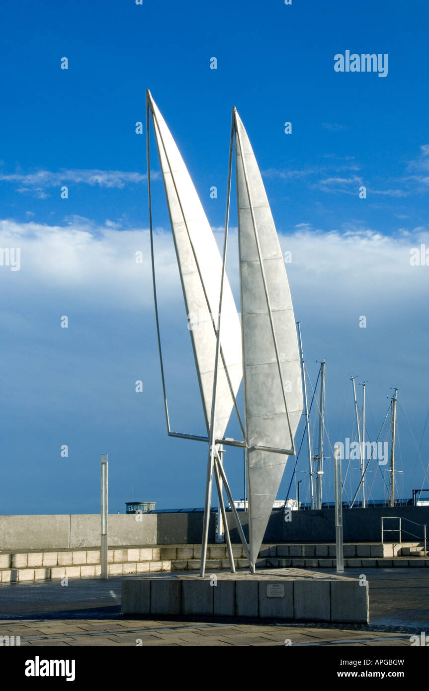 A sculpture of stylised boat sails by Eamonn O'Doherty at Dun Laoghaire harbour near Dublin, Ireland- 'Gaoth - Stock Image