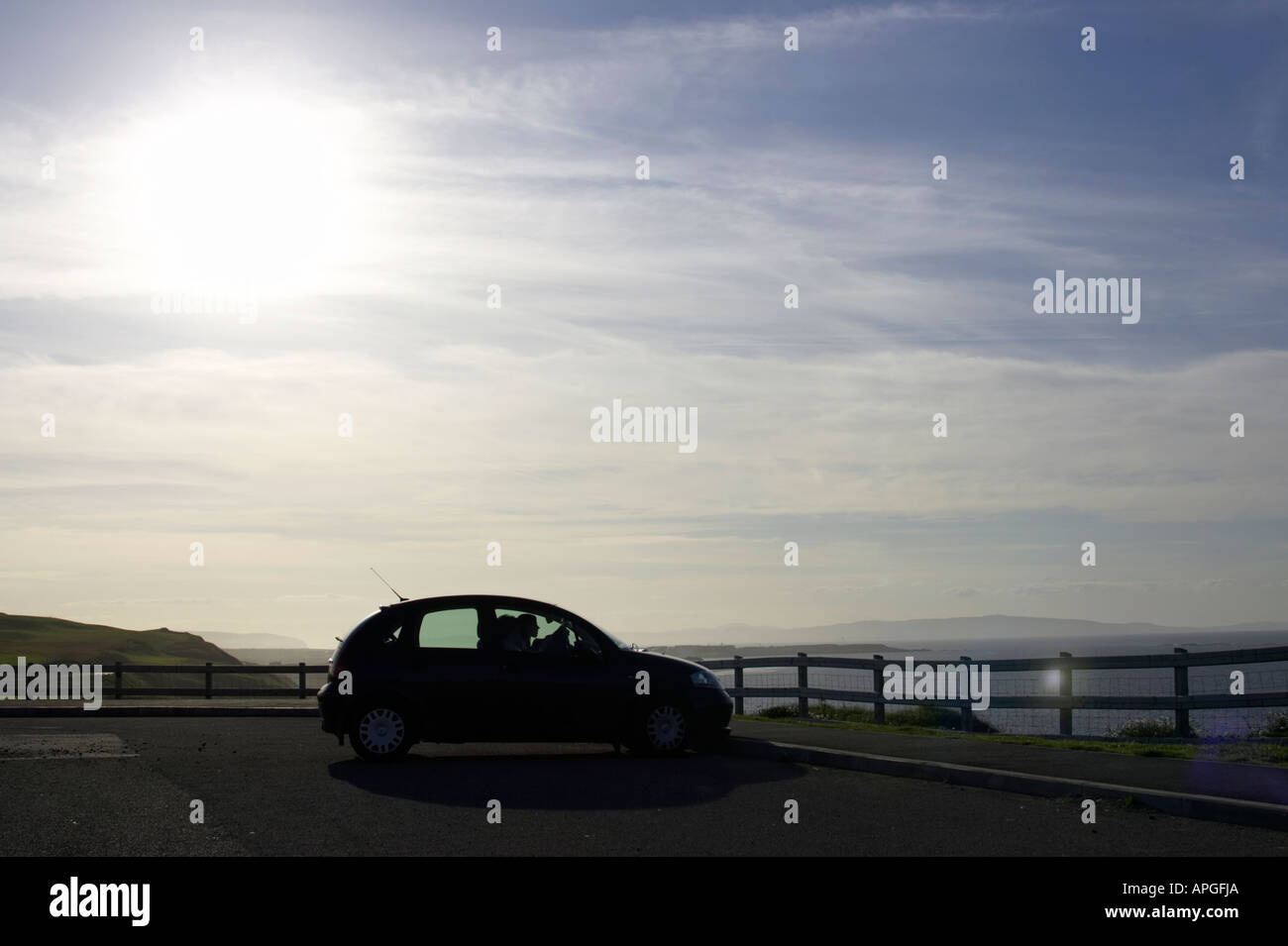 silhouette of car sitting in car park tourist amenity area on north antrim causeway coast county antrim northern Stock Photo