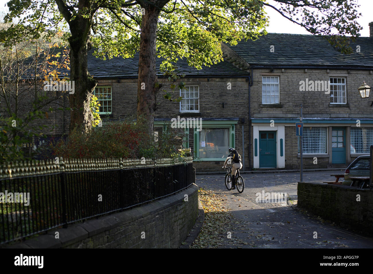 Mountain Biker Nick Craig Rides out of the Town of Hayfield and into the Peaks. Stock Photo