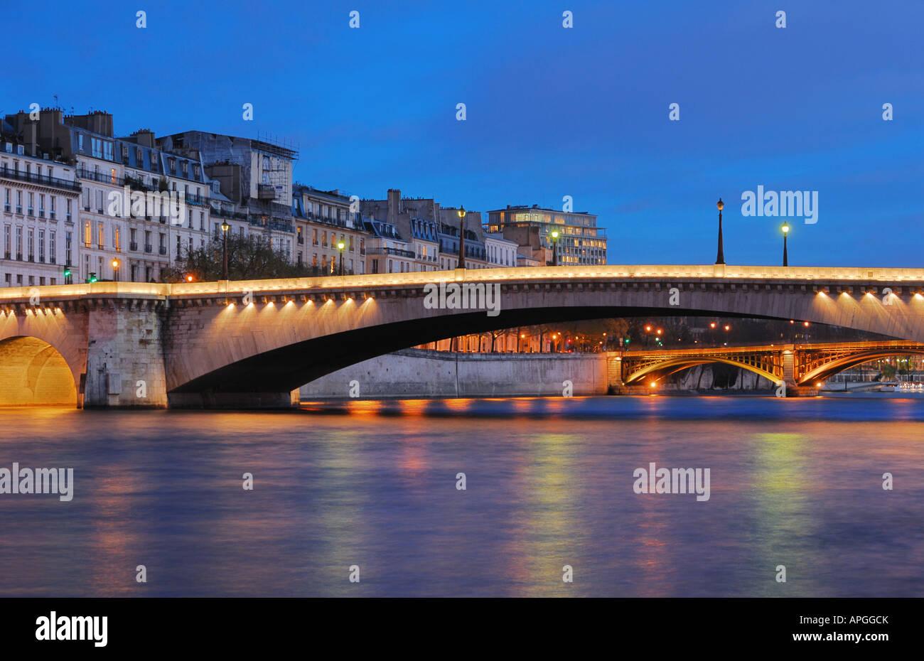 Saint-Louis Island Aand de la Tournelle Bridge at the blue Hour, Paris, France - Stock Image