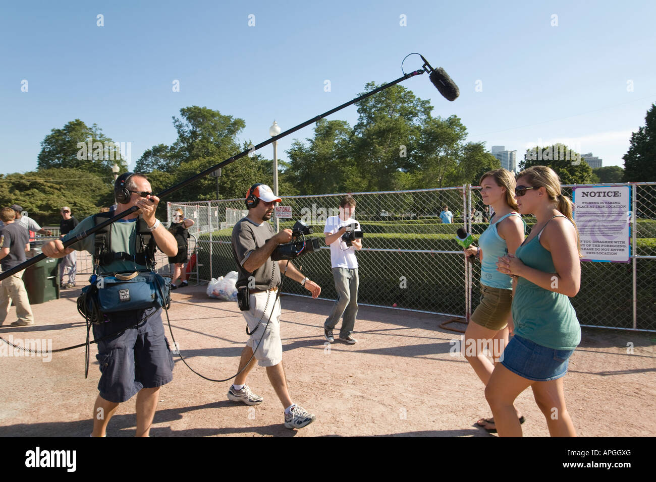 ILLINOIS Chicago Female young adult interviewed and filmed before entering Lollapalooza musical concert venue in - Stock Image