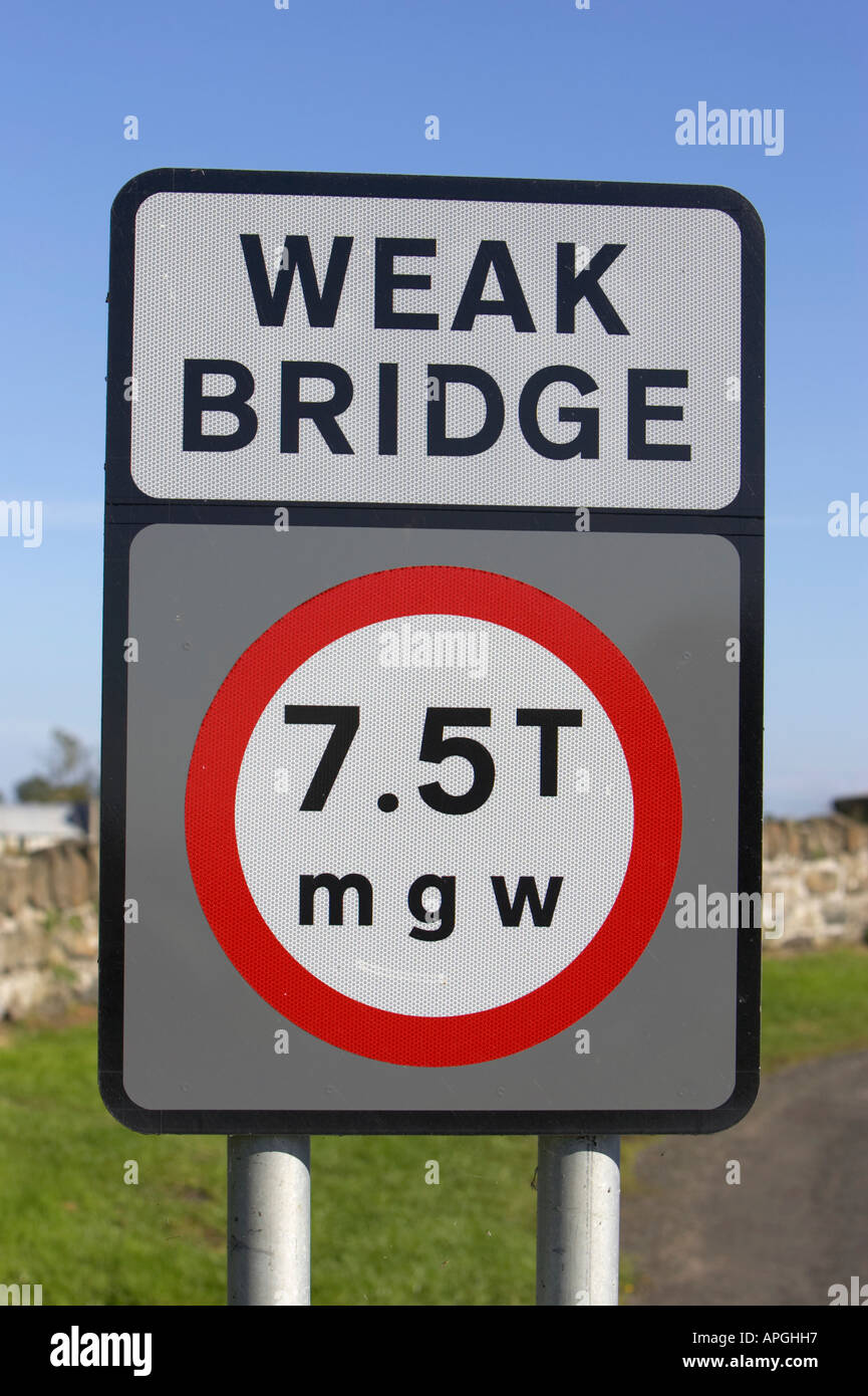 close up of weak bridge 7 5 tonnes mgw weight restriction road sign near old stone bridge county londonderry northern ireland - Stock Image