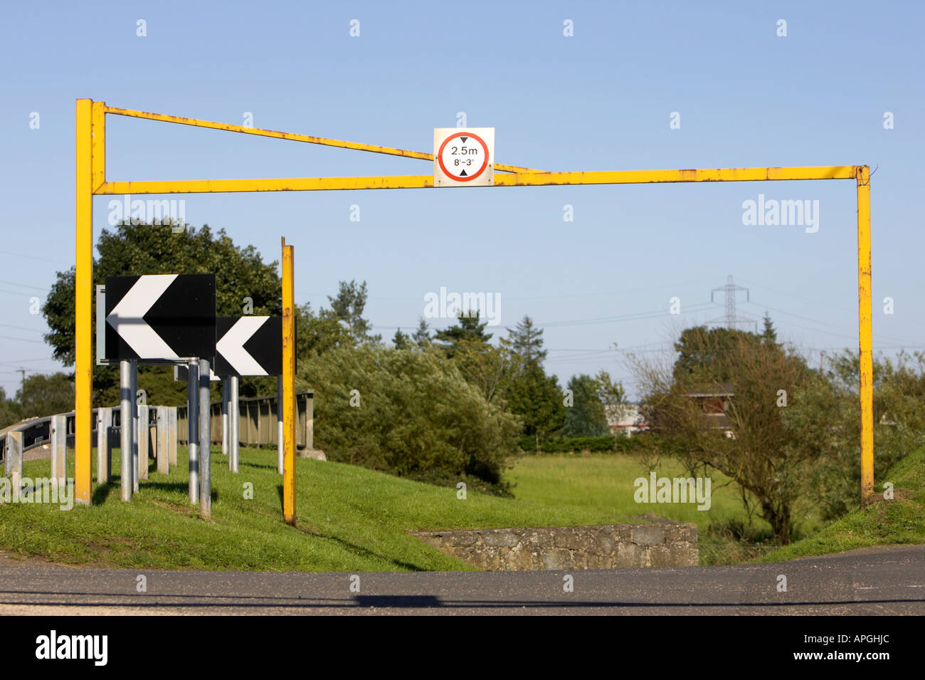 maximum height road sign above a yellow barrier to rural car park entrance to avoid overnight and HGV parking - Stock Image