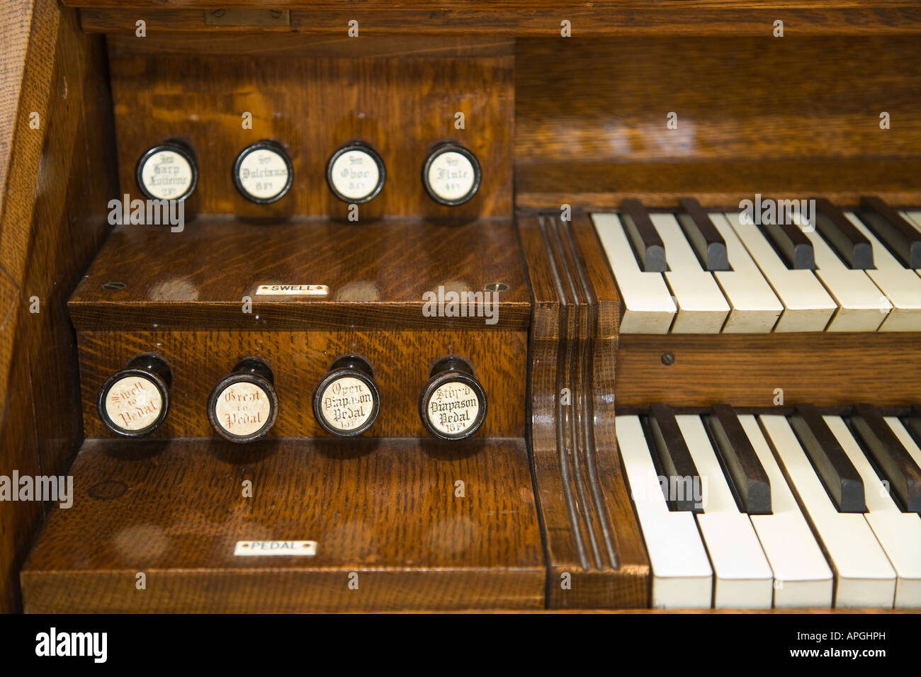 ILLINOIS Rockford Keyboard pulls and stops on wooden organ Midway Village Community Church - Stock Image