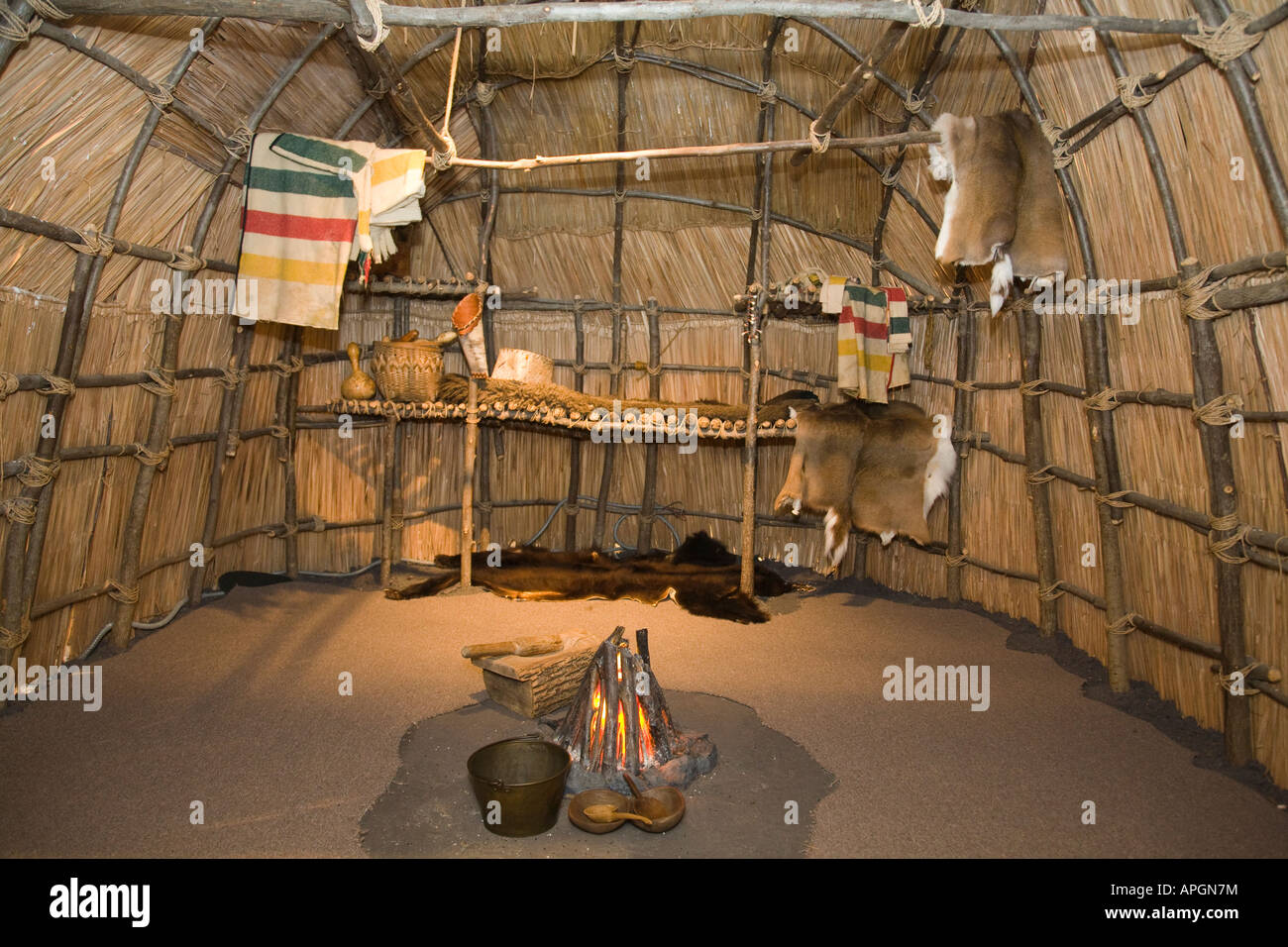 ILLINOIS Rockford Interior of wigwam Native American house plains Indians blankets pots and animal skins - Stock Image
