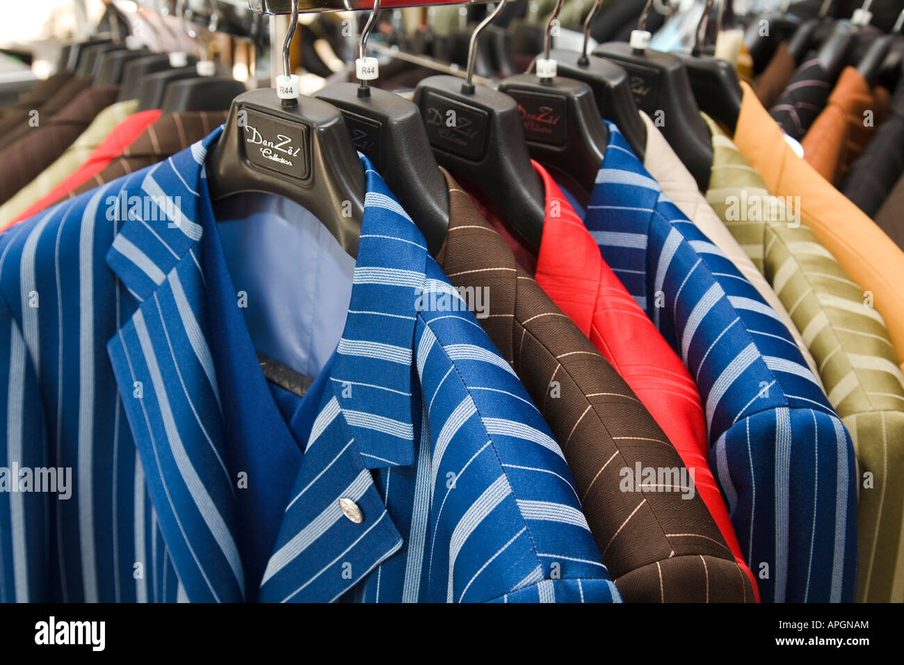 7d8bc763757f ILLINOIS Rockford Striped suit coats hanging on rack in mens and womens  clothing store African American