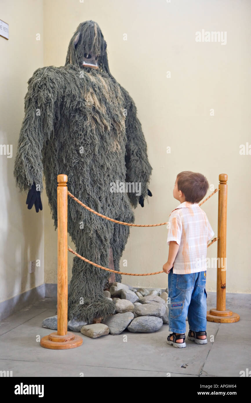 Boy looks at Yeti in the International Mountaineering museum