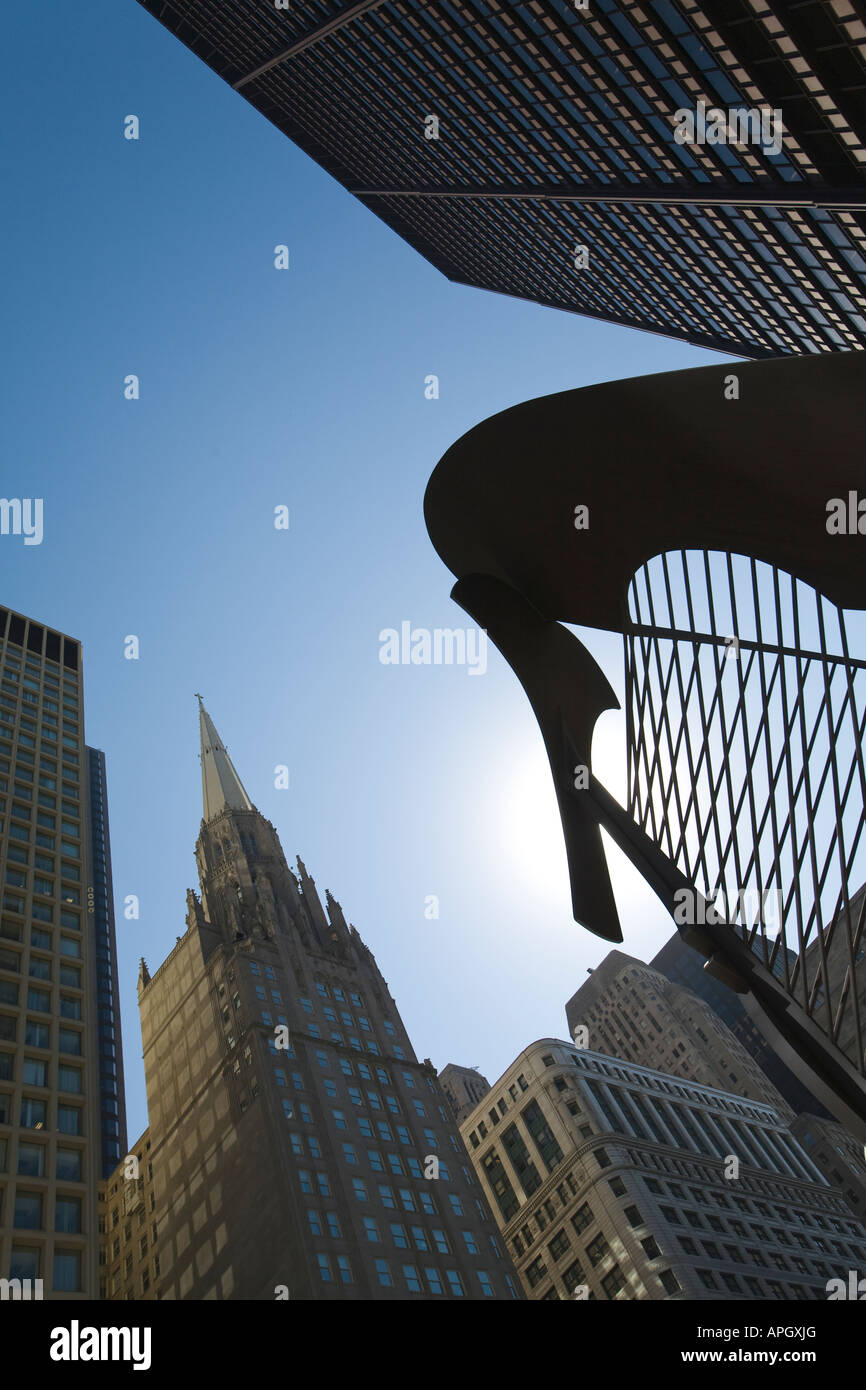 ILLINOIS Chicago Outline of untitled sculpture by Pablo Picasso in Daley Plaza blue sky top of office buildings Stock Photo