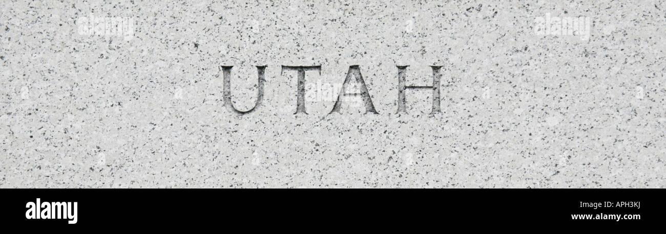Utah state name written in grey granite stone Stock Photo
