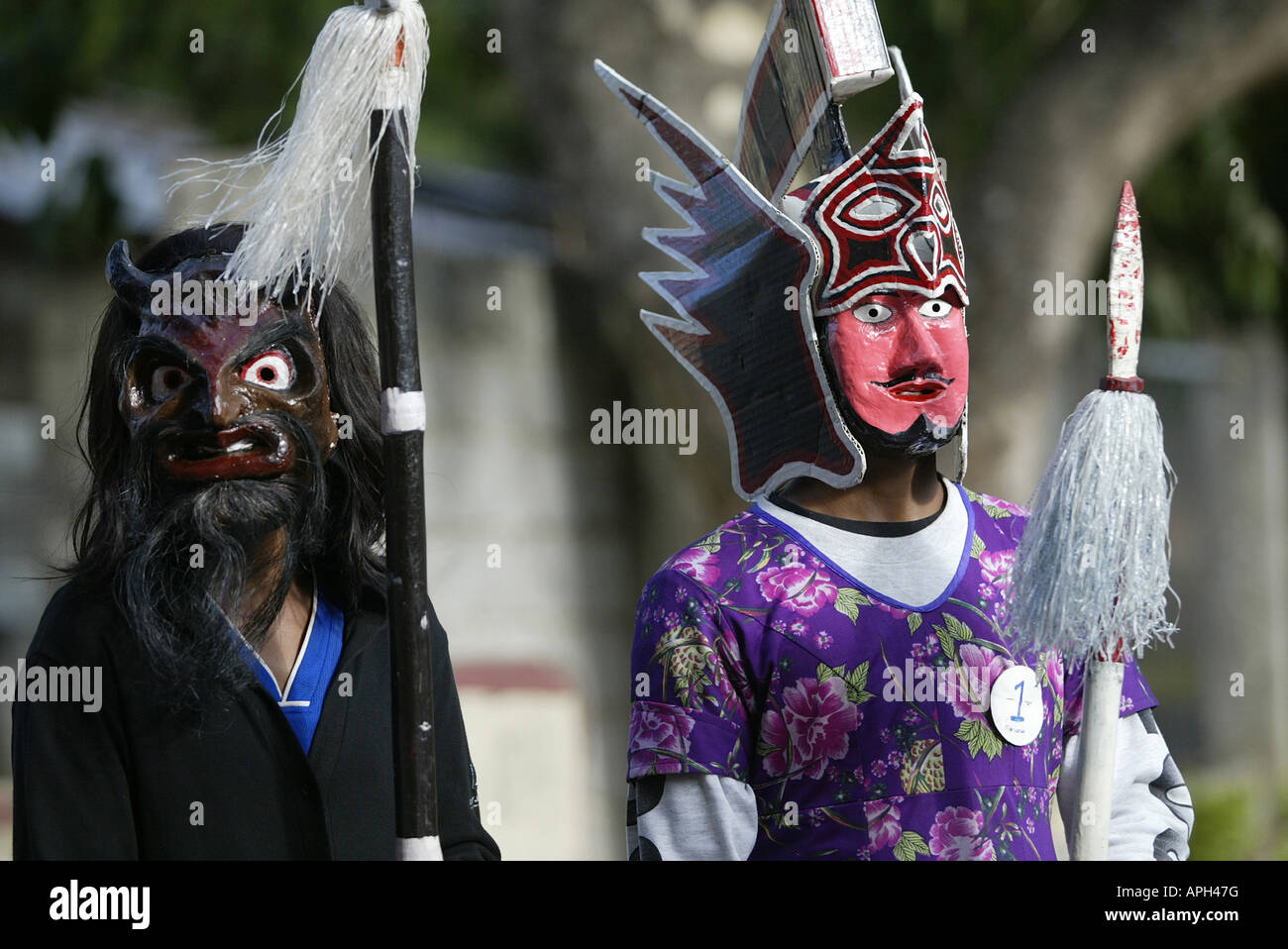 Filipino's portray Satan and a Roman soldier during Good Friday in Mansalay, Oriental Mindoro, Philippines. Stock Photo
