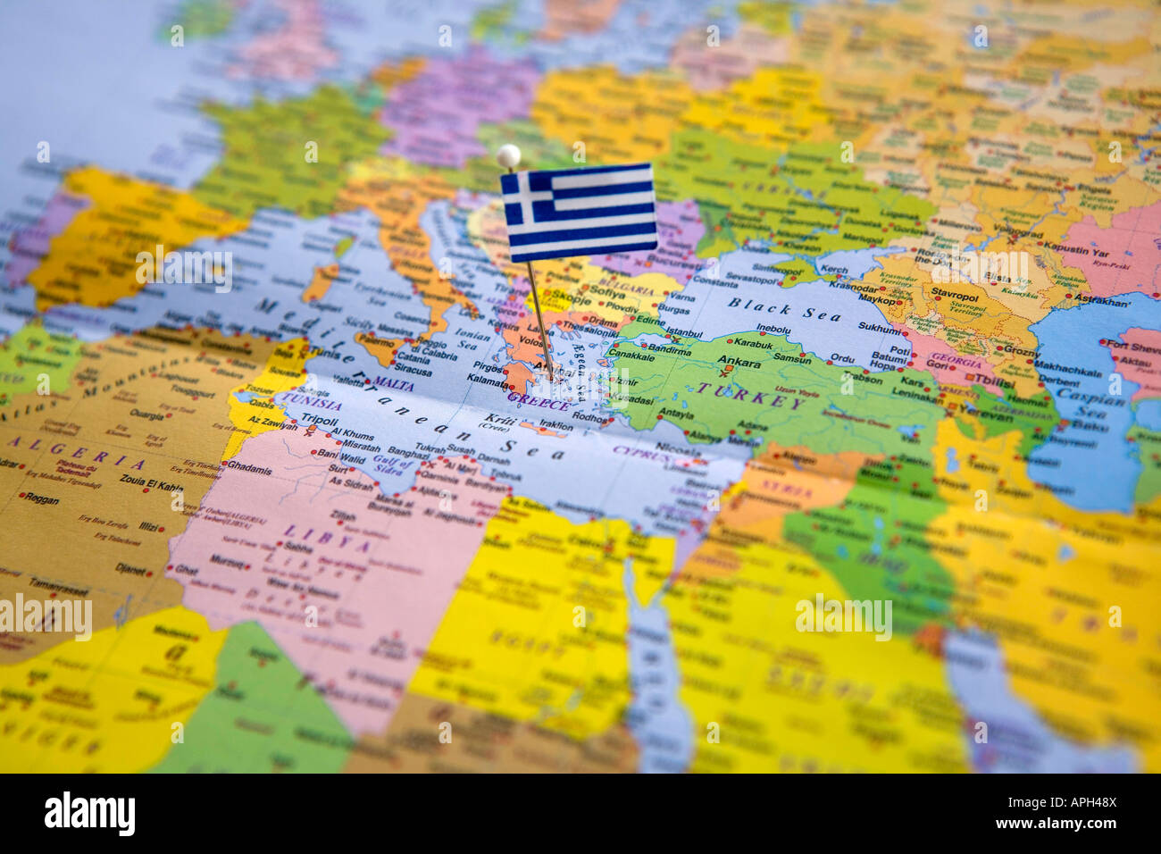 Greece On Map Of World.Flag Pin Placed On World Map In The Capital Of Greece Athens Stock