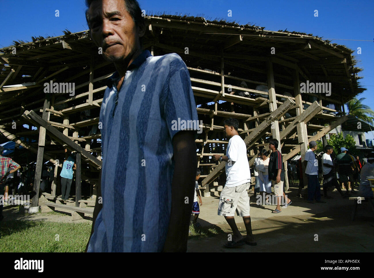Filipinos outside a rural cockhouse in Oriental Mindoro, Philippines. Stock Photo