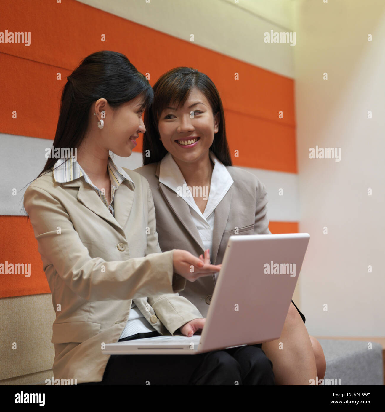 Two Businesswoman Looking at a Laptop - Stock Image