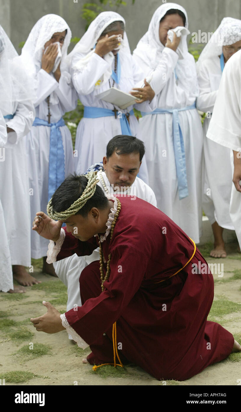 A Filipino man portrays Christ while reenacting the Passion at a Catholic Church in Mansalay, Oriental Mindoro, Stock Photo