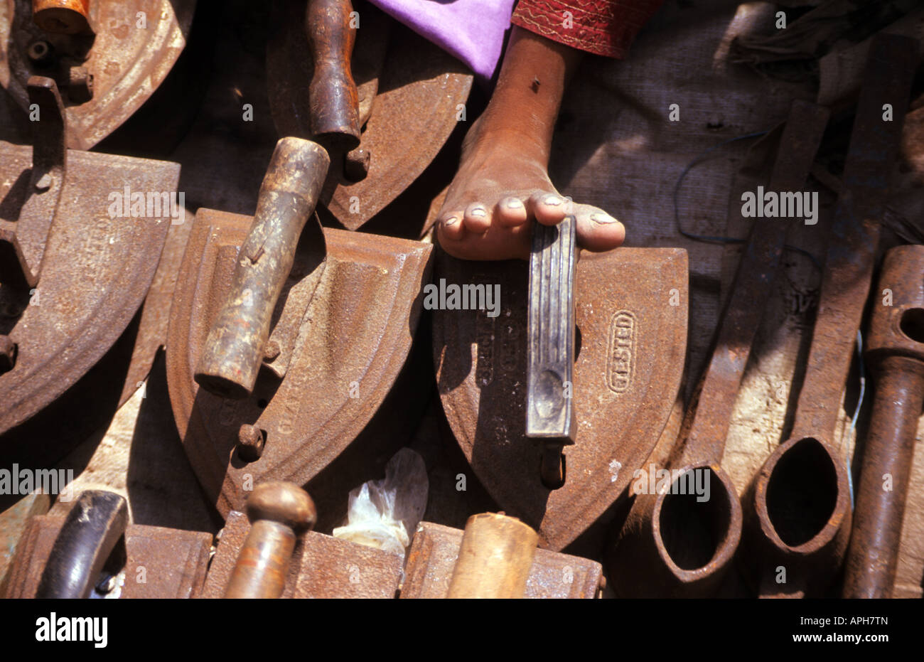 Old Irons sold in the colorful Sunday market in Ahmedabad - Stock Image