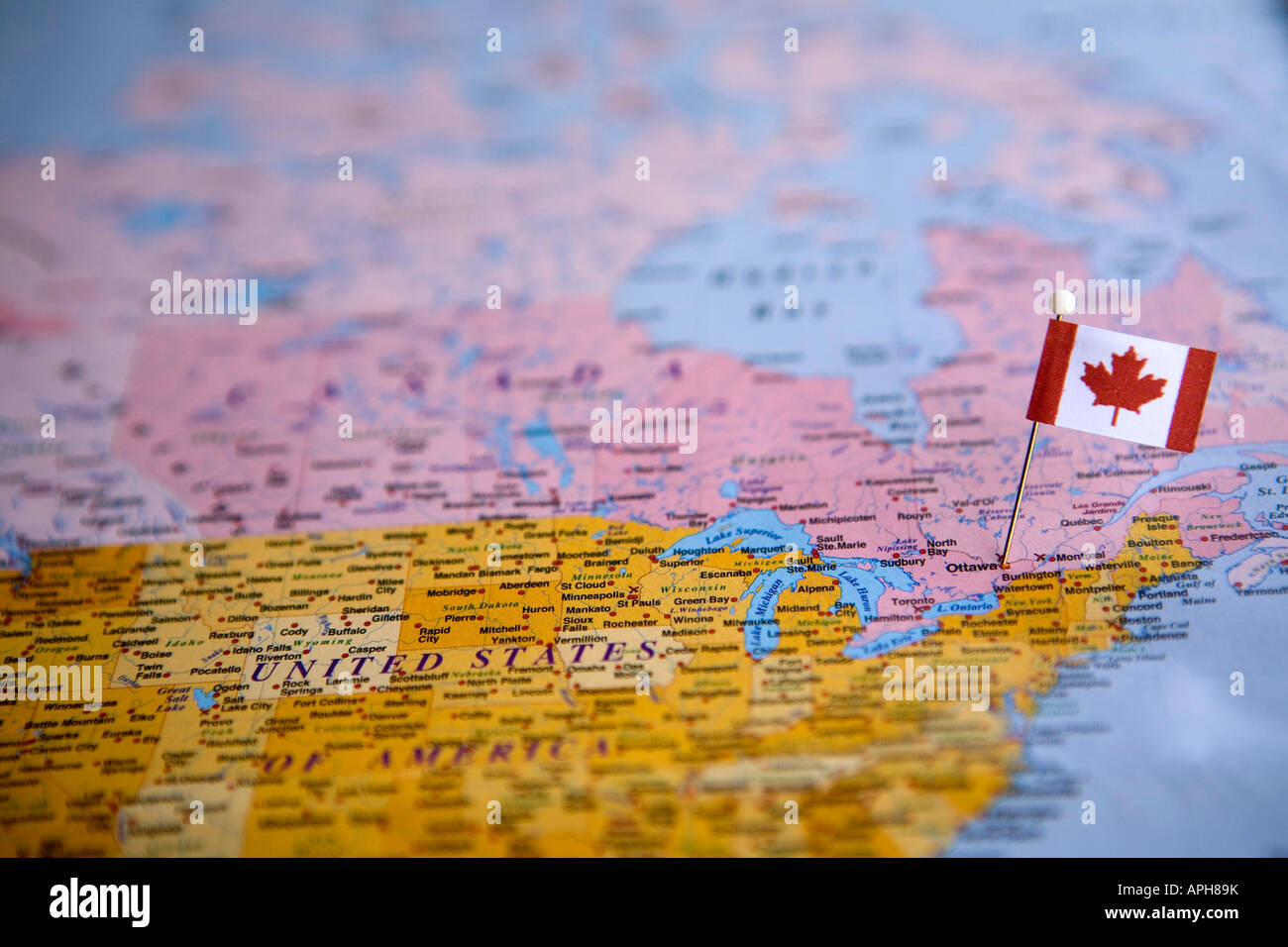 flag pin placed on world map in the capital of canada ottawa