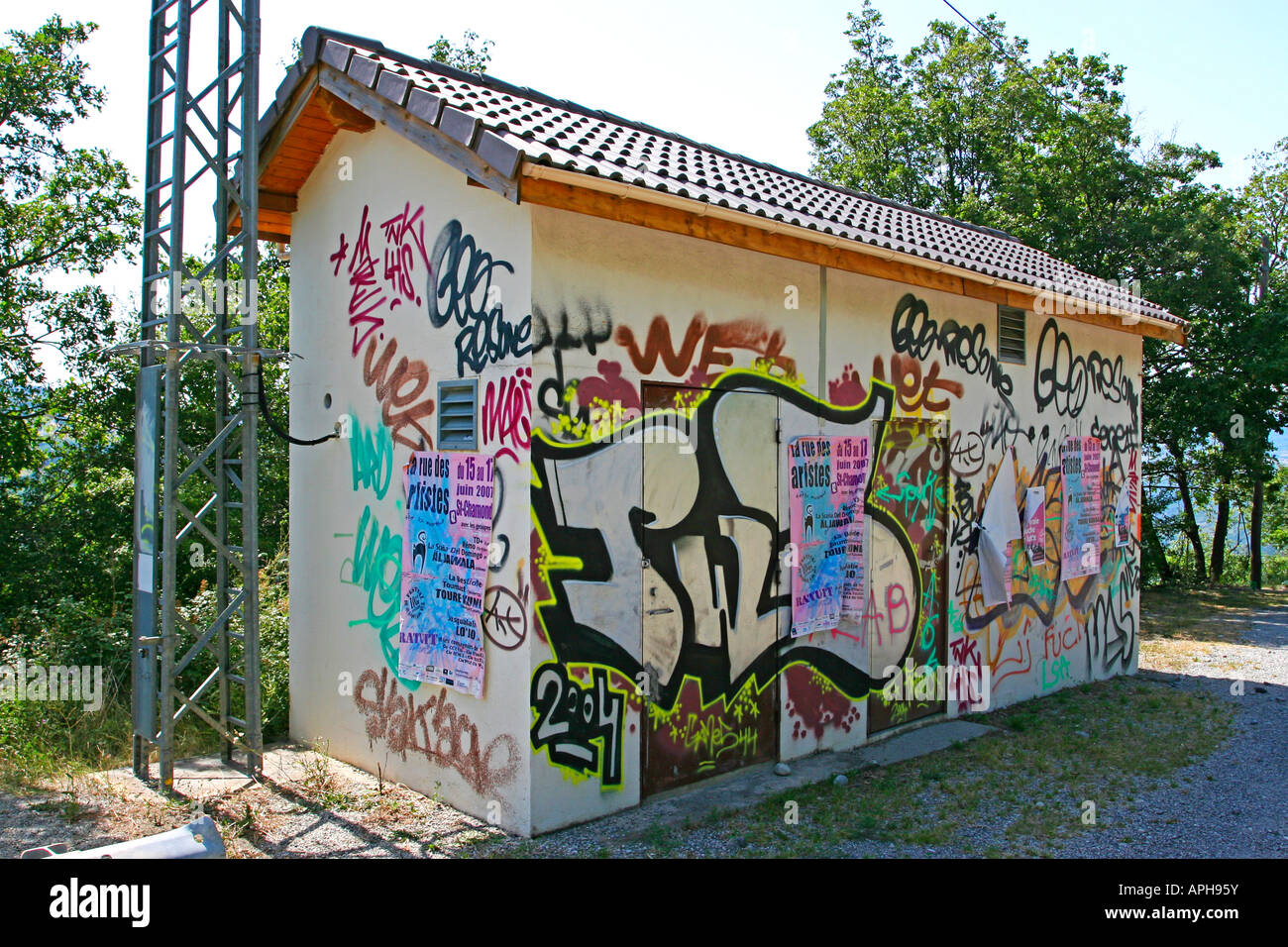 Graffiti and fly posters on a French electrical sub station - Stock Image