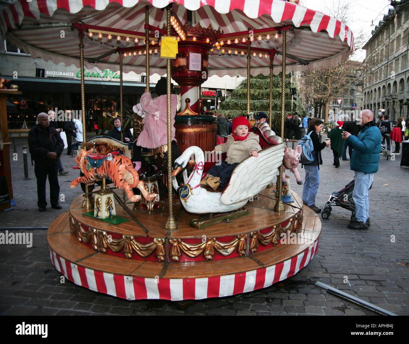 Merry Go Round Werdmuhleplatz Christmas market Zurich Old Town - Stock Image