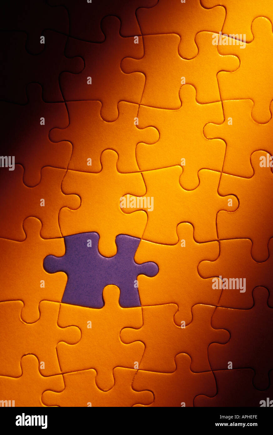 Blue puzzle piece fitted in in yellow puzzle - Stock Image