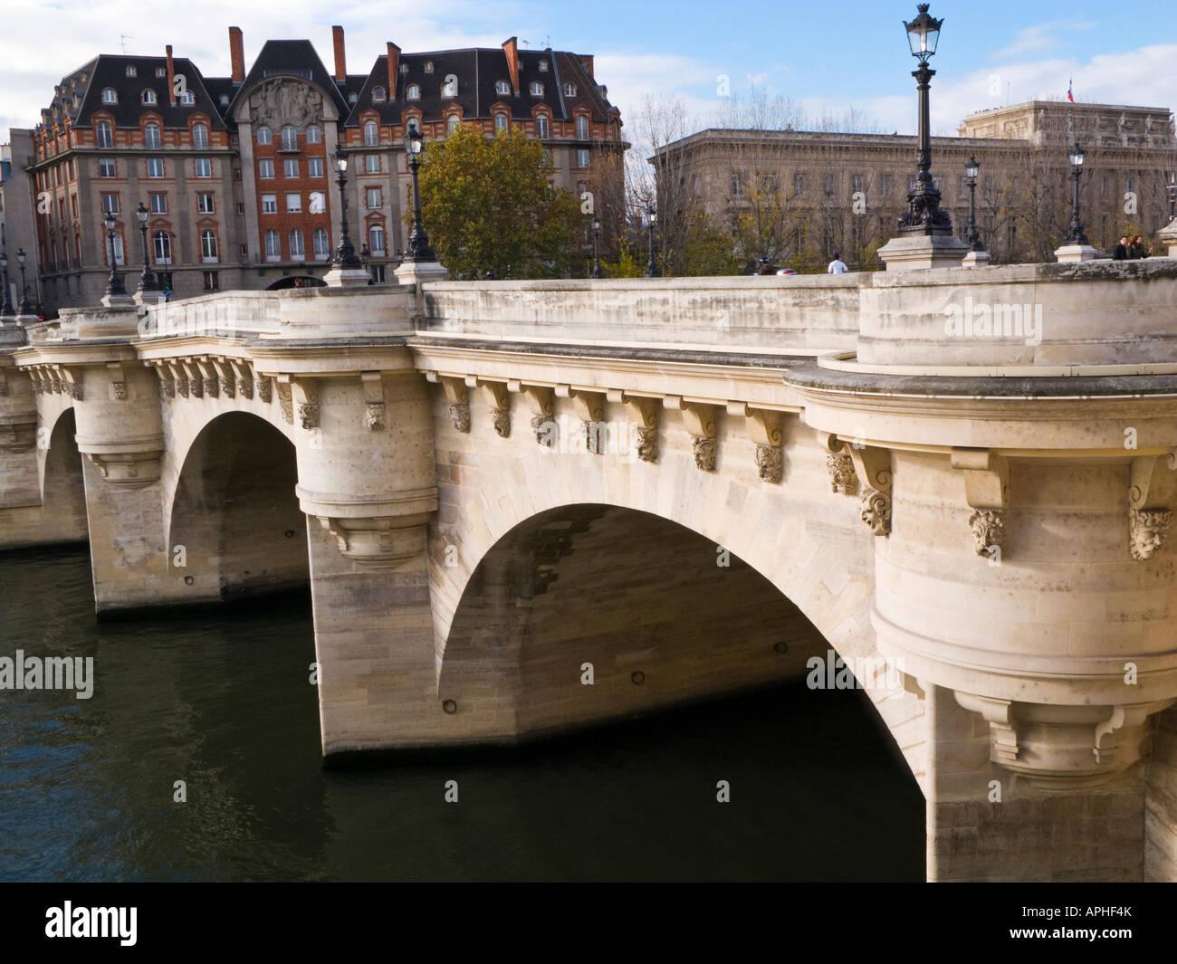 Pont Neuf bridge towards Ile de la Cite Paris France from Quai de la Megisserie - Stock Image