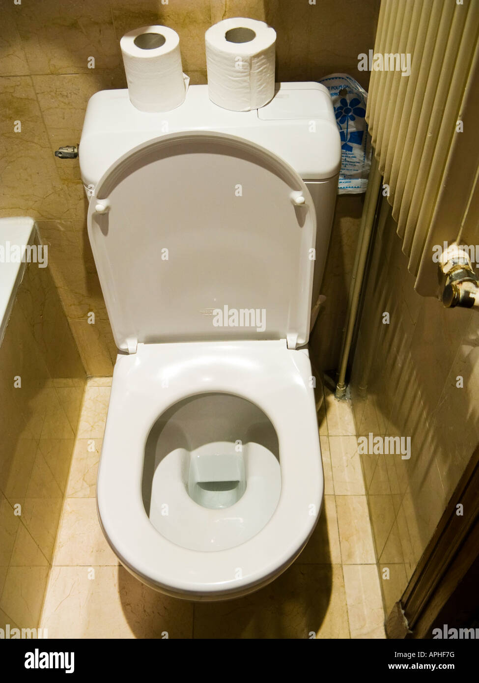 Toilet wc in a small hotel bathroom - Stock Image