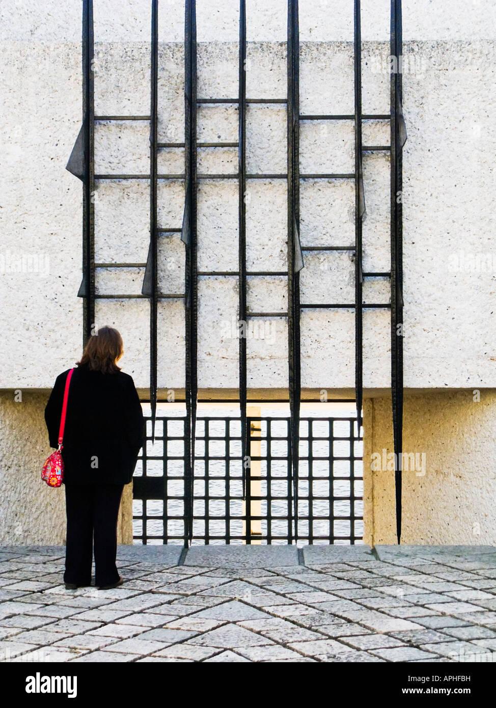 Woman paying respects at the Martyrs Francais de la Deportation memorial Ile de la Cite Paris France Europe - Stock Image