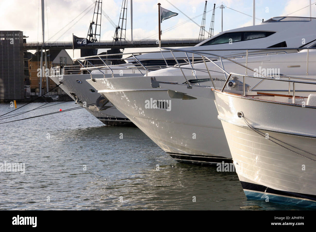 View across the bow of three yachts moored up at the London Boat Show Stock Photo