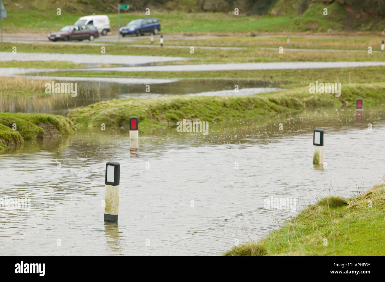 A road near Sunderland Point Morecambe Bay UK flooded by a combination of high tide and storm force winds Stock Photo