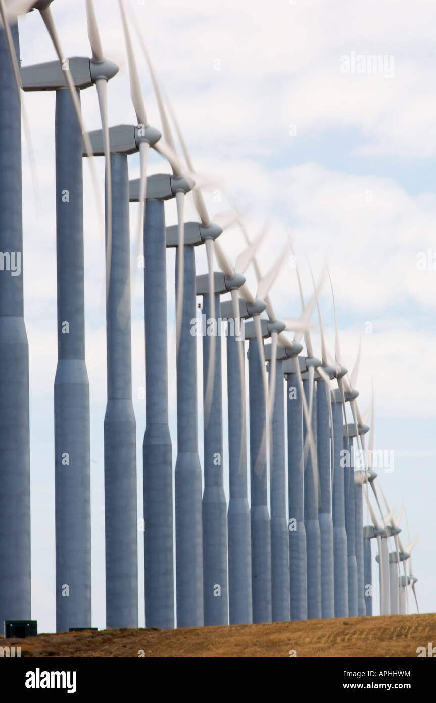 The propellers of a line of wind turbines spin in the wind as they generate electricity in Southeast Washington - Stock Image