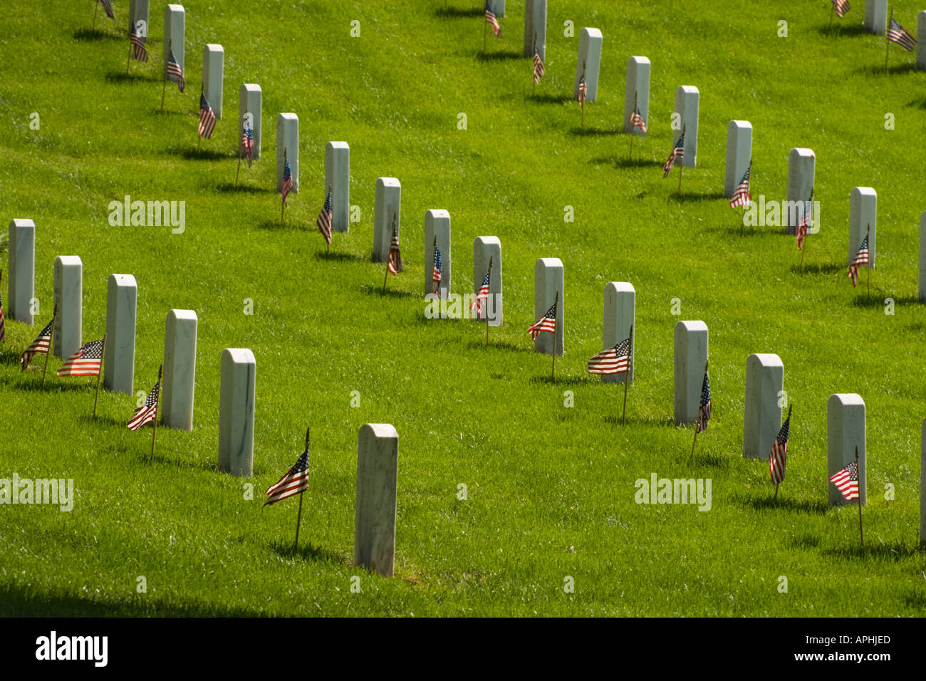 Rows of headstones with small flags on Memorial Day at Arlington National Cemetery. Stock Photo