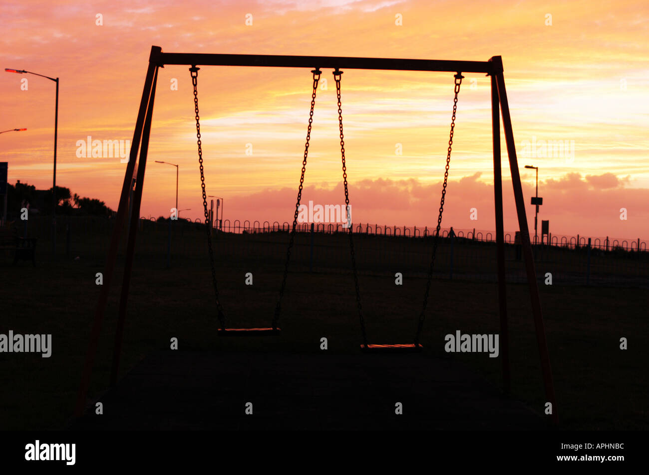 Swings In Park At Sunset Stock Photo 5157307 Alamy
