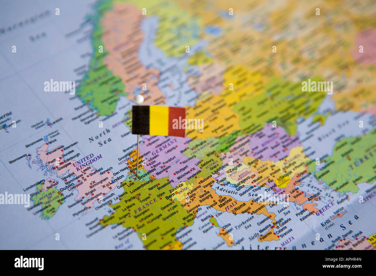 flag pin placed on world map in the capital of belgium brussels stock image